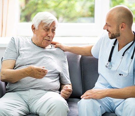 Elder patient talking with doctor ALS