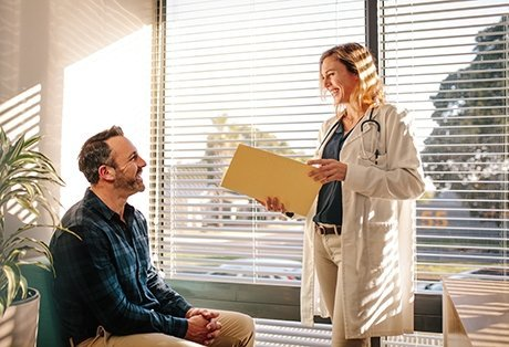 Patient sitting talking with doctor