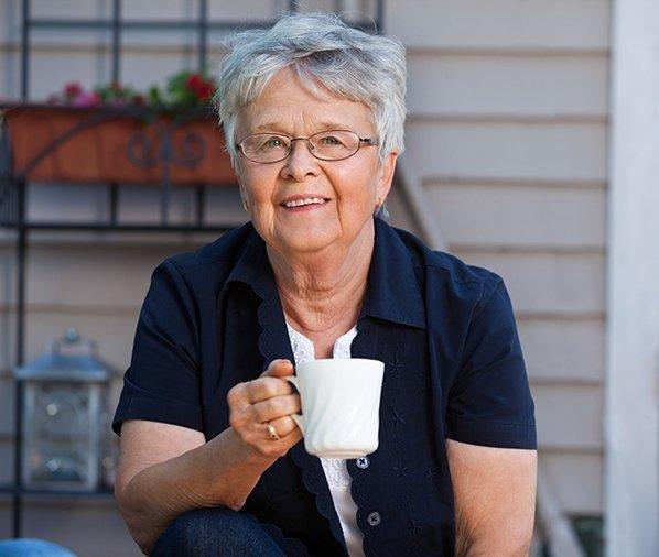 senior woman having cup tea