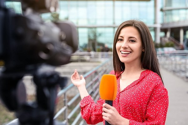 female news reporter speaking