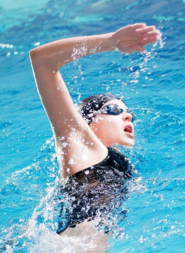 Young woman competetive swimming