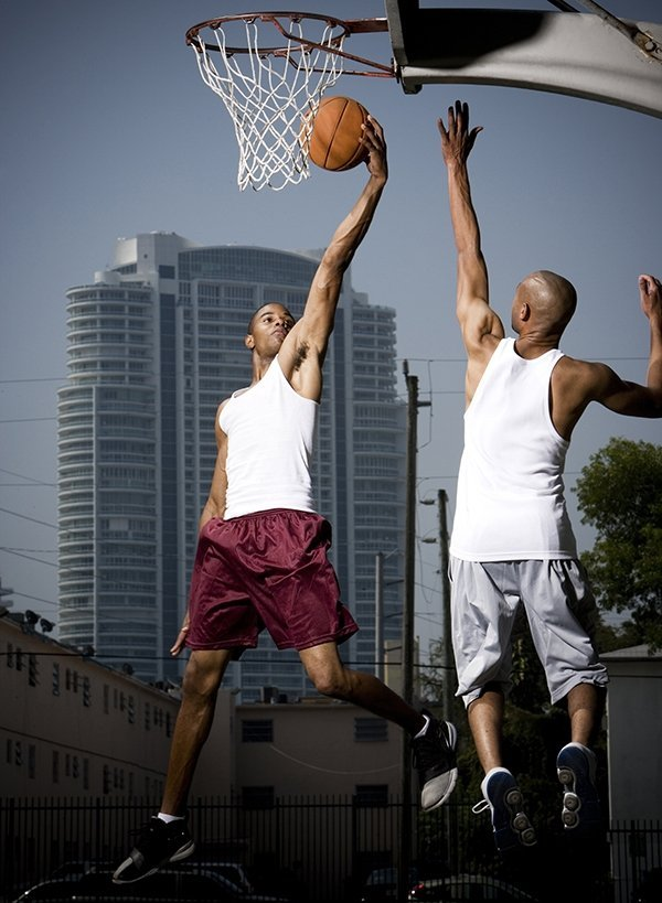 Two friends competing in basketball