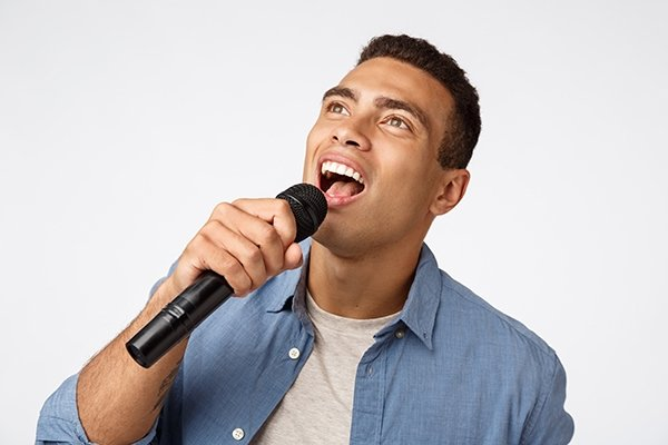 vocalist singing male latino