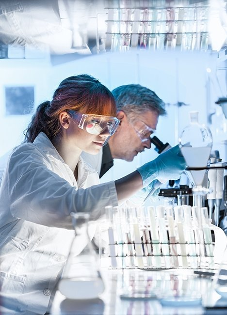 health care researchers working laboratory